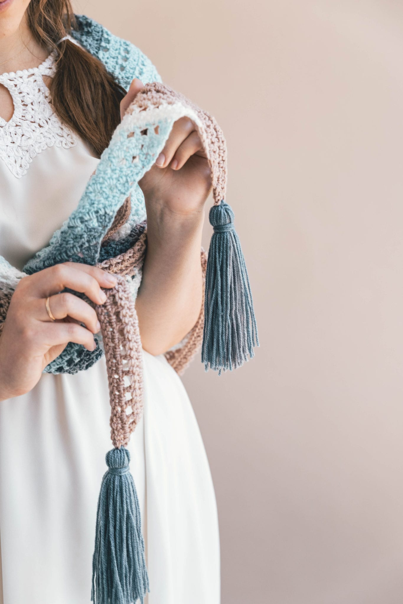 easy stitches and drapey tassels make for a effortless crochet wrap
