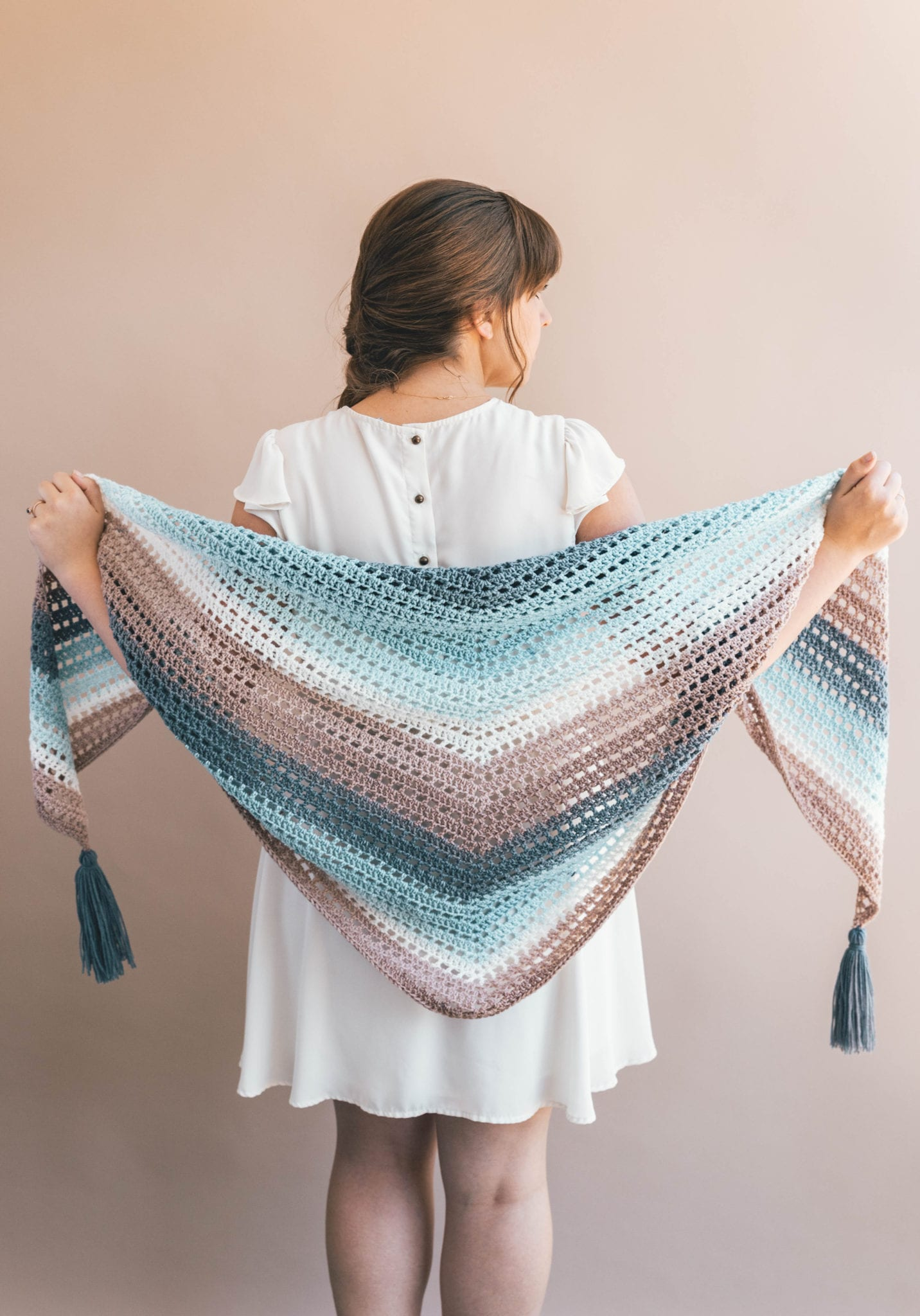 cake yarn creates a stunning faded effect in this crochet wrap shawl.
