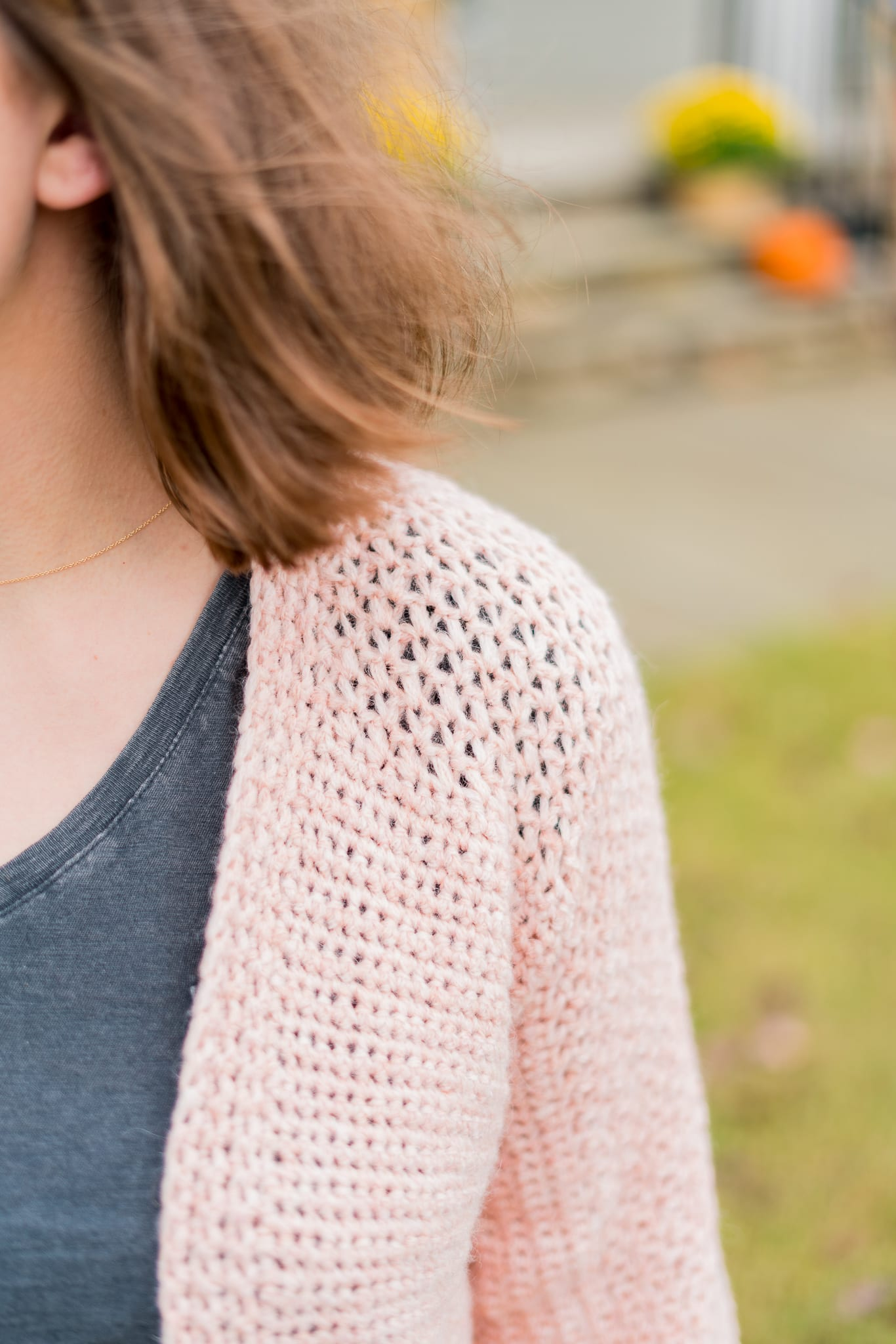 Easy crochet cardigan with lace detailing on the shoulder.