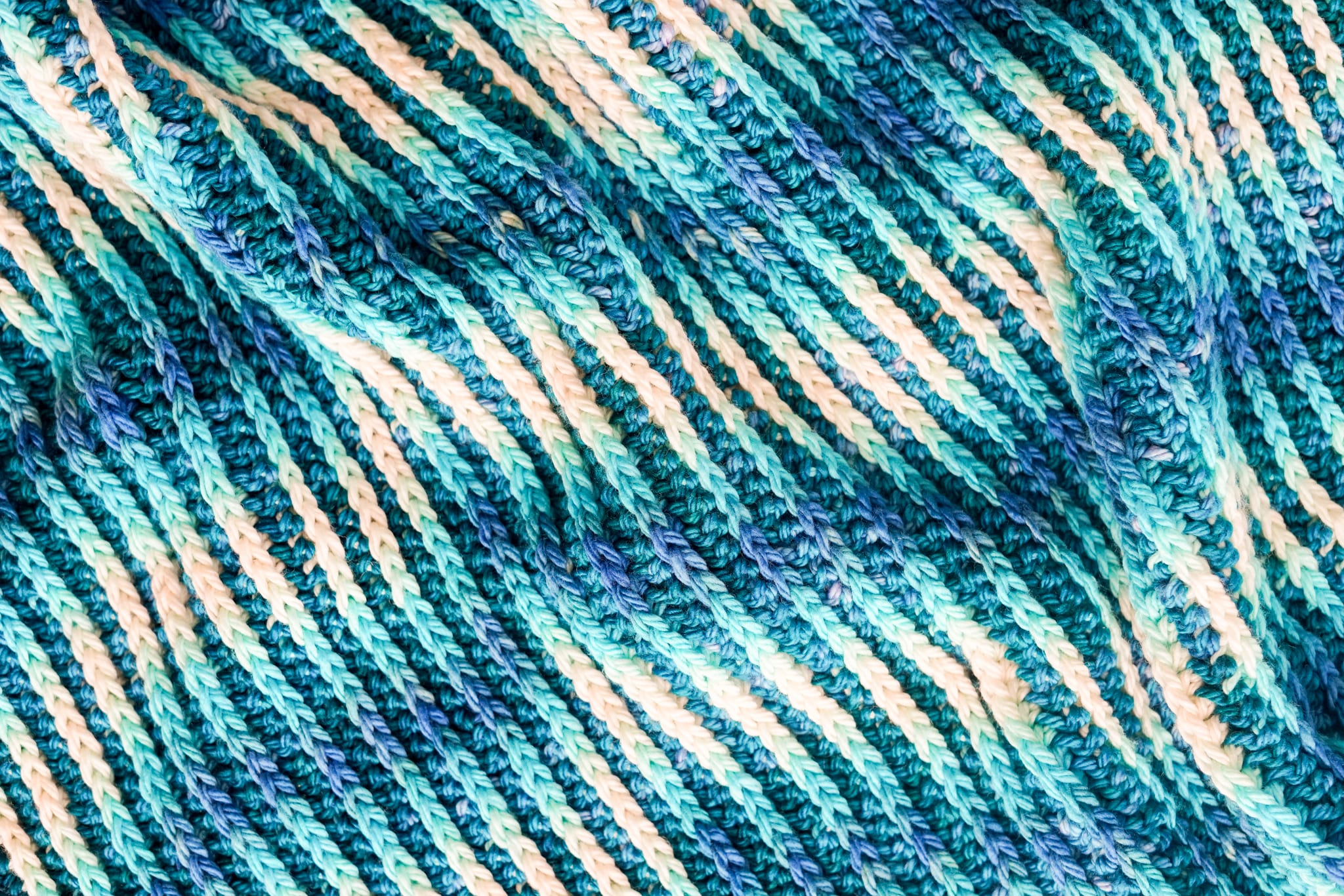crochet blanket using hand dyed yarn and color pooling